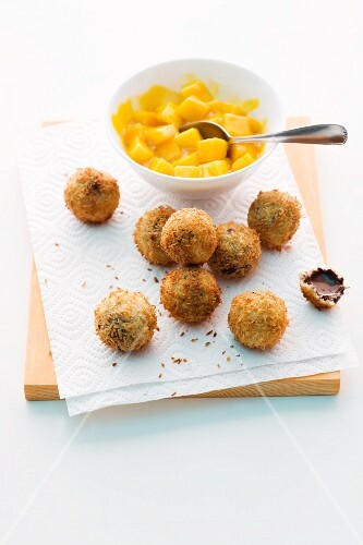 Deep-fried chocolate and coconut balls with mango