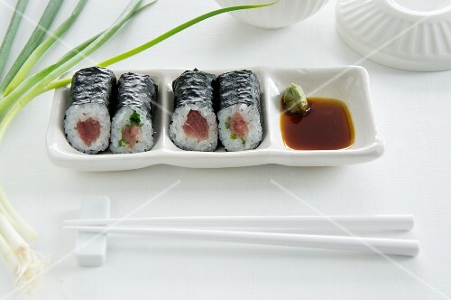 Maki sushi with tuna, salmon and cucumber, with soy sauce and wasabi