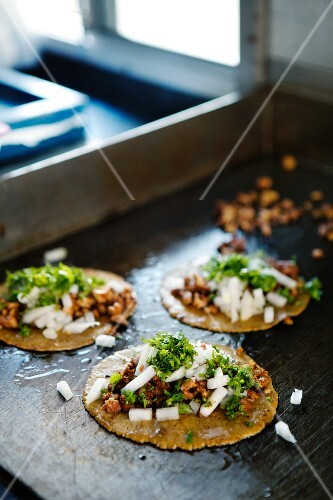 Taco al pastor (corn tortillas with pork, Mexico)