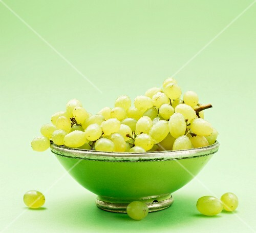 Green grapes in a green bowl