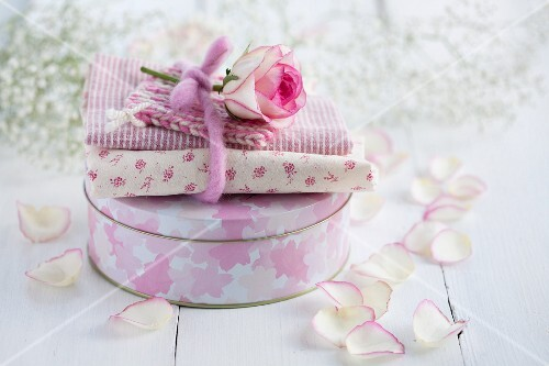 Cake tin decorated with floral fabric and rose