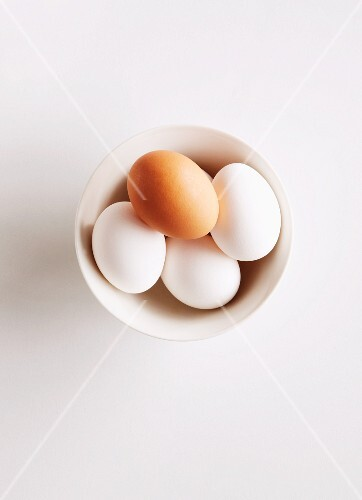 Fresh eggs in a dish