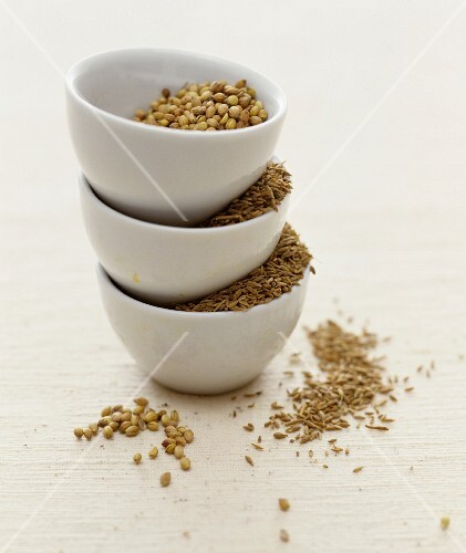 Caraway and coriander in small bowls