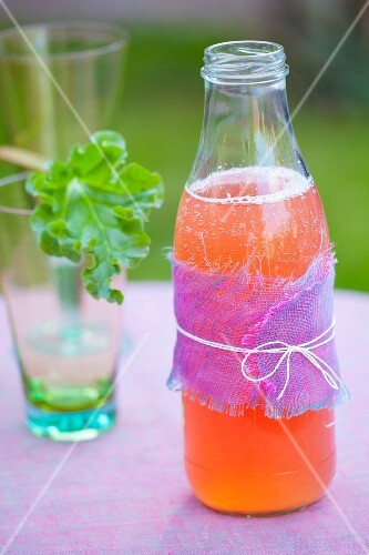Homemade rhubarb lemonade on a garden table