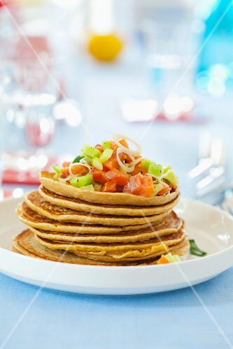 Wholemeal pancakes with salmon and cucumber salad