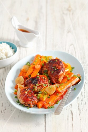 Chicken leg with carrots and oranges