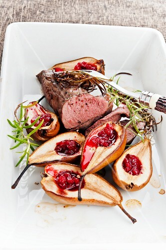 Venison fillet with baked pears and cranberries