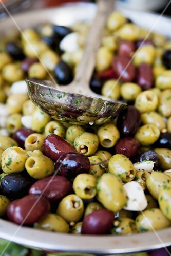 Pickled green and black olives with garlic and herbs