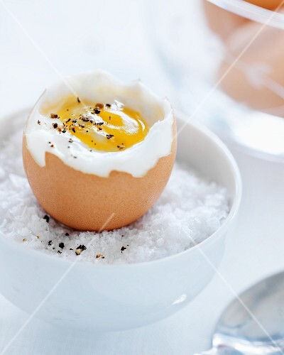 Soft boiled egg in a bowl with salt