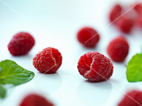 Several raspberries with leaves