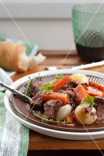 Tradional french dish Beef bourguignon with carrots and onions in a rich red wine sauce