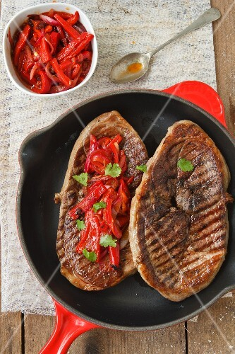 Steaks with red peppers