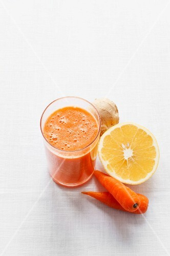 A smoothie with orange juice, carrots and ginger