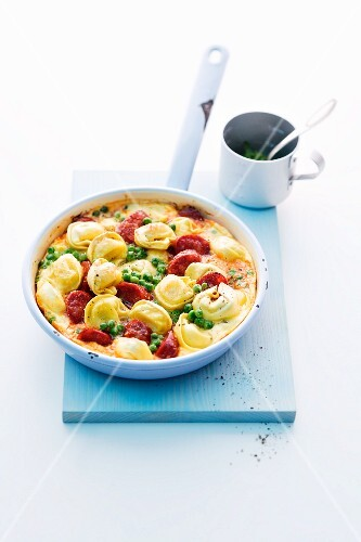 Spanish omelette with tortellini, chorizo and peas