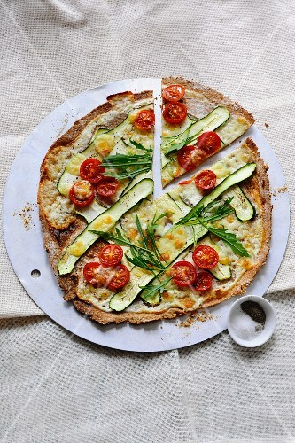 Tarte flambée with courgette, tomatoes and rocket