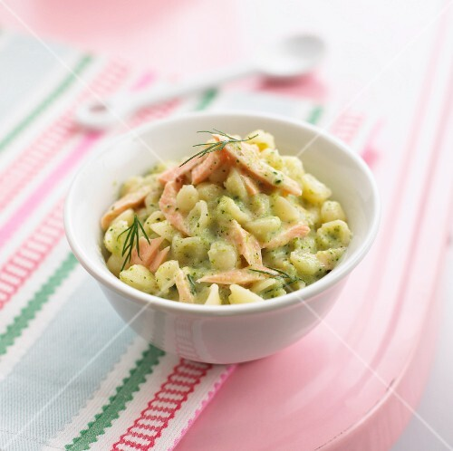 Pasta shells with strips of salmon in a broccoli sauce