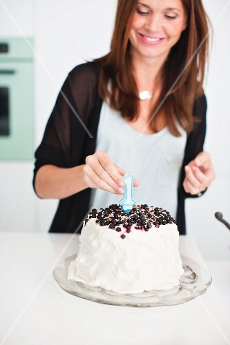 Woman preparing birthday cake