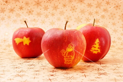 Three red apples with Christmas decoration