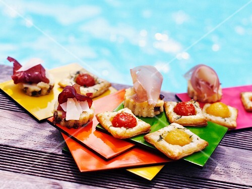 Assorted tartines on the edge of a swimming pool