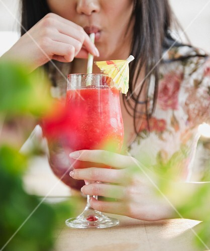 Korean woman drinking tropical cocktail