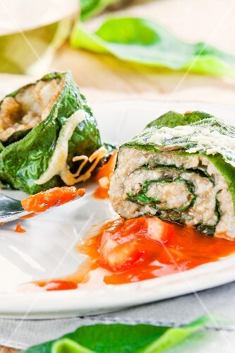 Rolled comfrey with freekeh filling and tomato sauce