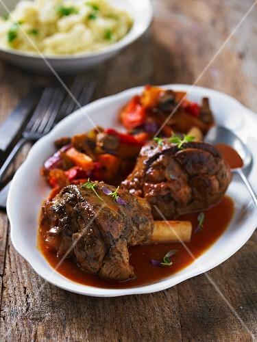 Braised lamb shanks with peppers