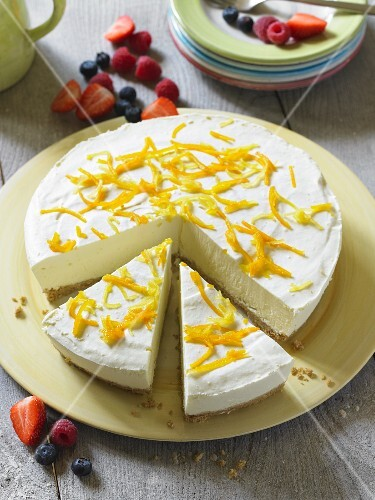 Cheesecake with lemon zest, partly sliced