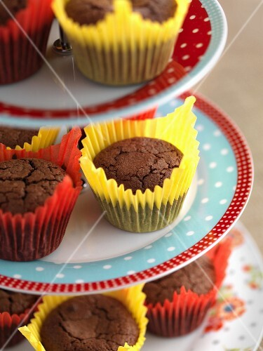 Gluten-free chocolate muffins on a tiered cake stand