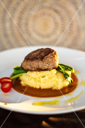 Beef fillet on mashed potato in a rosemary sauce