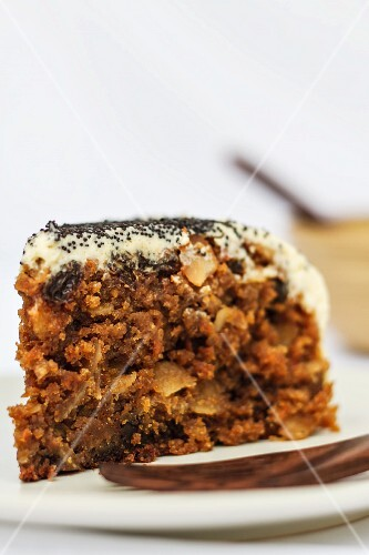 A slice of carrot cake with poppy seeds