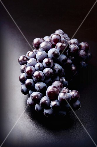 Red grapes on a dark surface
