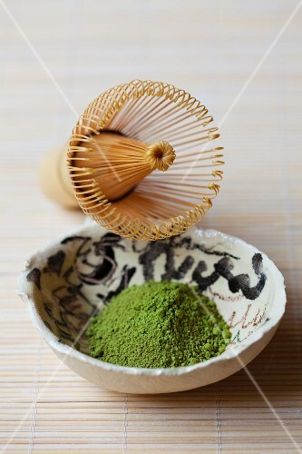 Matcha tea powder and a tea whisk