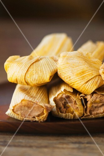 Stack of wrapped corn tamales