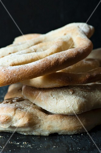 A stack of Fougasse bread close up.