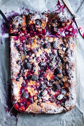 Blackberry cake, one slice removed