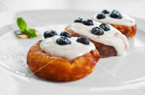 Czech pancakes with blueberries and cream