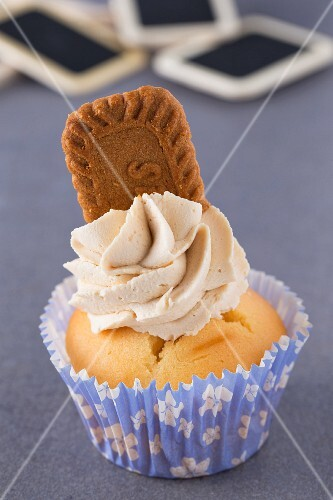 A cupcake decorated with a caramelised biscuit