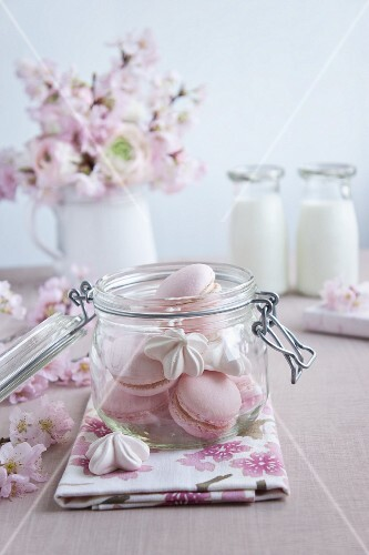 Pink macaroons and flower-shaped meringues