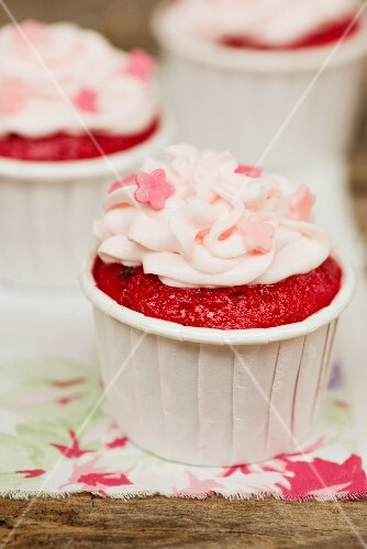 Red Velvet cupcakes decorated with sugar flowers