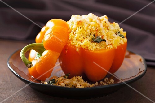 A stuffed yellow pepper filled with couscous