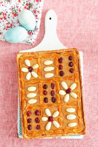 Mazurek (Easter cake, Poland) with caramel, almonds and cranberries