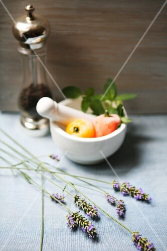 An arrangement with a mortar, pepper mill and lavender