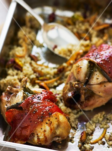 Roast stuffed quails wrapped in bacon