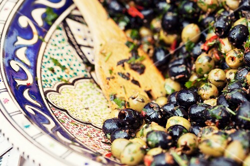 Marinated green and black olives