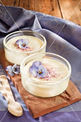 Cream desserts with edible flowers