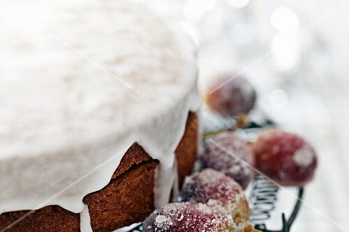 Sponge cake with icing sugar and sugared grapes