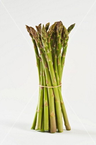 A bunch of green asparagus against a white background