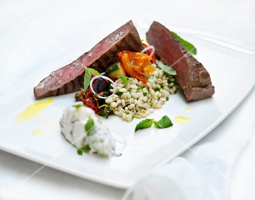 Beef steak with pearl barley and vegetables
