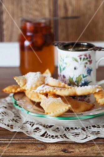 Khvorost (deep fried Russian pastries) with icing sugar
