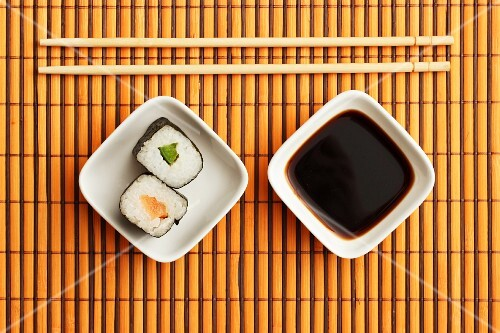 Maki sushi, soy sauce and chopsticks